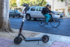 BIRD electric scooter nuisance to residents. LOS ANGELES, CALIFORNIA - JUNE 28, 2018: A wave of backlash is coming for BIRD`S CEO Travis VanderZanden. City stock photography