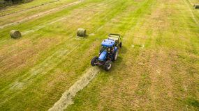 Bird eye of Man at work on the tractor with hay baler royalty free stock photography