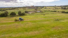 Bird eye of Man at work on the tractor with hay baler royalty free stock images