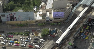 Bird eye view of big road with a lot of cars, trucks and moving train on railways stock footage