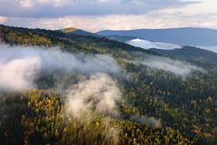 Mountain autumn forest landscape during foggy sunset. stock image