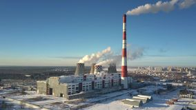 Bird eye view heating station building with towers and steam. Pictorial bird eye view powerful heating station building with cooling towers and steam at modern stock video footage