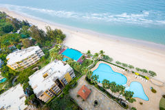 Bird eye view of hotel,  swimming pool, beach and sea. Royalty Free Stock Image