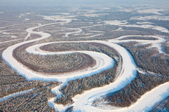 Bird eye view onto forest river in winter Royalty Free Stock Image