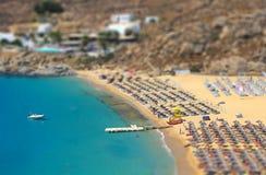Bird eye view of sandy beach and blue lagoon Stock Photos