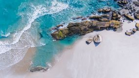 The bird eye view of sea scape and group of beach stones. The bird eye view of sea scape and group of beach stones photo from drone in outdoor sun lighting royalty free stock photo