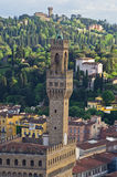 Bird eye view on a tower of Vecchio palace in Florence with surrounding Tuscany hills in a background Royalty Free Stock Photos