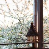 Bird feeder on balcony. Empty wooden bird feeder on the house terrace Royalty Free Stock Photography