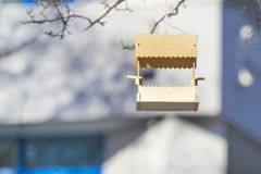 Bird feeder. Feeder for birds in the urban building background Stock Photography