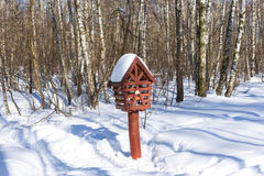Bird feeder box in the snow covered forest Royalty Free Stock Photo