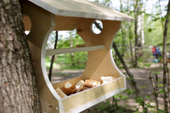 Bird feeder with bread Royalty Free Stock Photography