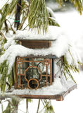 Bird Feeder Covered in Snow Royalty Free Stock Photo