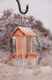 Bird feeder covered in thick layer of ice Stock Photos