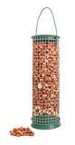 Bird feeder filled with peanuts and some nuts lying loose. Isolated on a white background Royalty Free Stock Images
