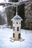 Bird feeder with frost on the roof royalty free stock photo