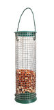 Bird feeder half full of peanuts Royalty Free Stock Images
