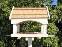 Bird feeder house. With bird food Royalty Free Stock Photography