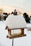 Bird Feeder with Pile of Snow Royalty Free Stock Photography