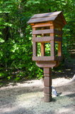 The bird feeder. A place for feeding birds in the forest Stock Images