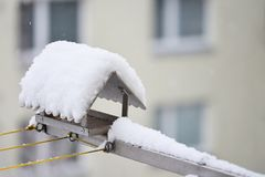 Bird feeder in winter with snow. Home on the balcony. Royalty Free Stock Images