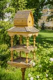 Bird Feeders. Beautiful wooden bird feeders in the park royalty free stock image