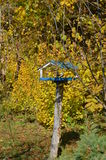 Bird Feeders. In the fall foliage Royalty Free Stock Images