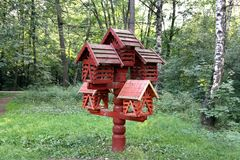 Bird feeders. In the form of houses in the park stock photography
