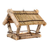Bird feeders made of birch with a thatched roof Stock Image