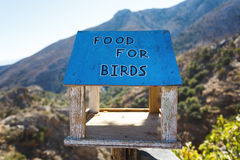 The bird feeders. In a mountains of Crete, Greece stock images