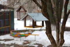 Bird feeders on the playground.  stock photography