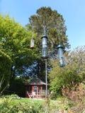 Bird Feeders. Squirrel proof bird feeders hanging in a garden stock photo