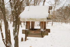 Bird feeders. tree house for the birds in winter Stock Photo
