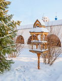 Bird feeders. Winter landscape with bird feeders in the form of house stock photo