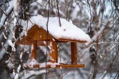 Bird feeders in winter snowy park. Outdoor. Bird feeders in winter snowy park stock photos