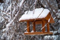 Bird feeders in winter snowy park. Outdoor. Bird feeders in winter snowy park stock photo