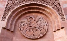 A bird feeding its chicks its blood - old symbol of self-sacrifice on the wall of Armenian Orthodox church in Moscow stock image