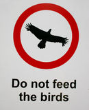Bird feeding sign Royalty Free Stock Photos