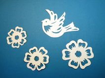 Bird and flowers. Paper cutting. Stock Photography