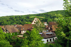 Bird-fly overview to small village in Alsace. France. Summer day Royalty Free Stock Photos