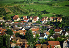 Bird-fly overview to small village in Alsace. France. Summer day Royalty Free Stock Photo
