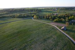 Bird is flying high. Aerial view of a land Royalty Free Stock Image