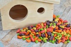 Bird food and little house Stock Photos