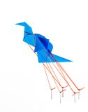 Bird of freedom. Paper crane chained down. Traditional Japan origami. Isolated Stock Photo