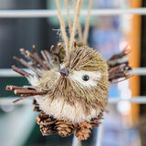 Bird handmade of wood and cone Stock Image