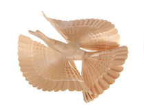 Bird of happiness. The wooden bird - a happiness symbol - flies Royalty Free Stock Images