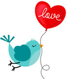 Bird holding love heart balloon Stock Image