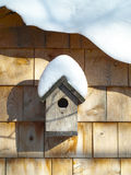 Bird house. Natural cedar bird house in whiter stock photos