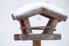 Bird house. A wooden bird house covered in snow royalty free stock photography