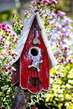 Bird House. Old purple wooden bird house in garden stock photo