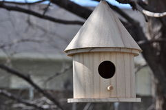 Bird House. Small,wooden bird house in a tree stock images
